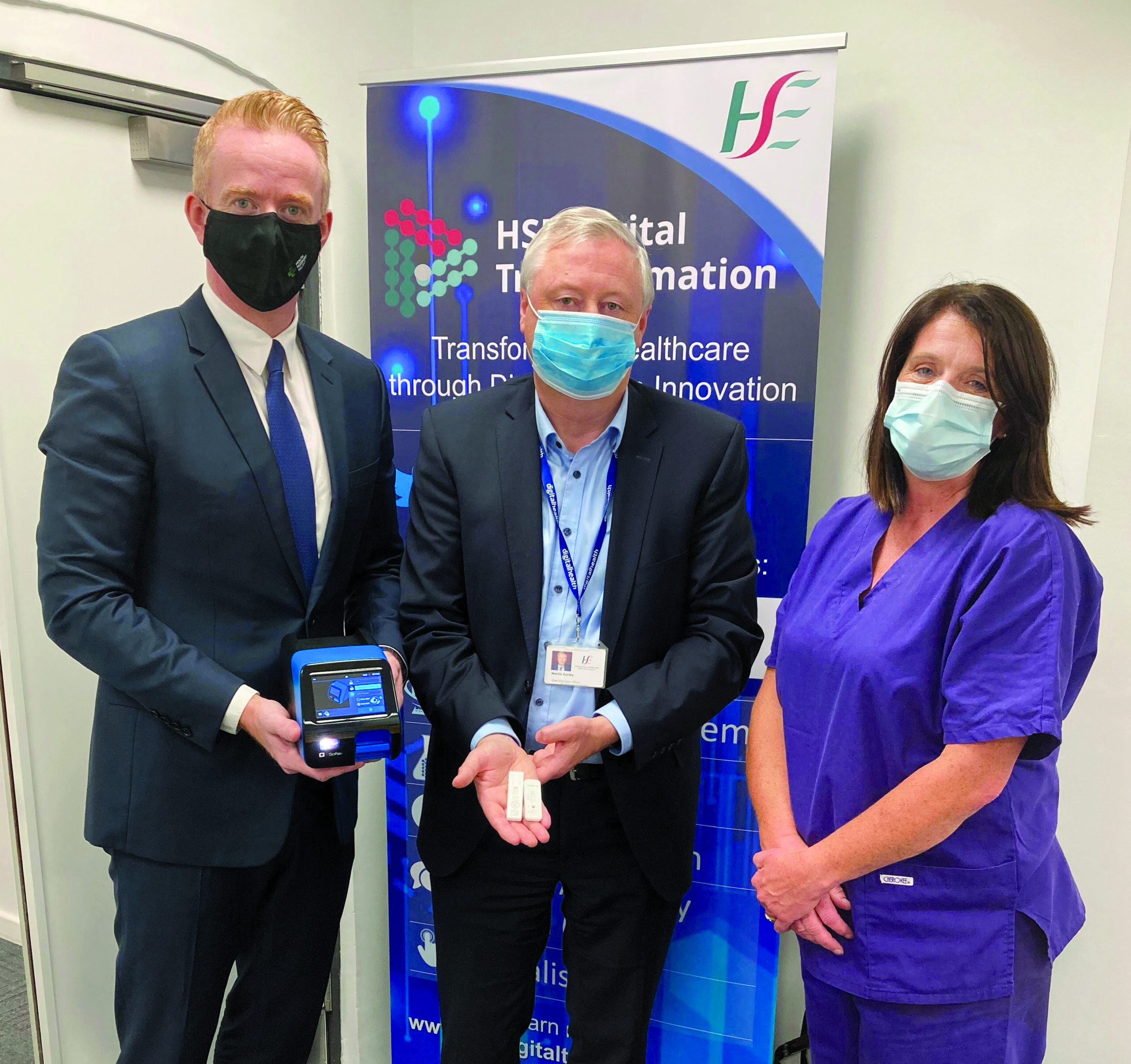 Pictured at the live demonstration of digital platform Health Passport Ireland and following rapid antigen testing are (l to r): Robert Quirke, CEO of ROQU Group, Prof. Martin Curley, Director of Digital Transformation and Open Innovation at the HSE, Liz Connelly, Infection Prevention & Control Nurse